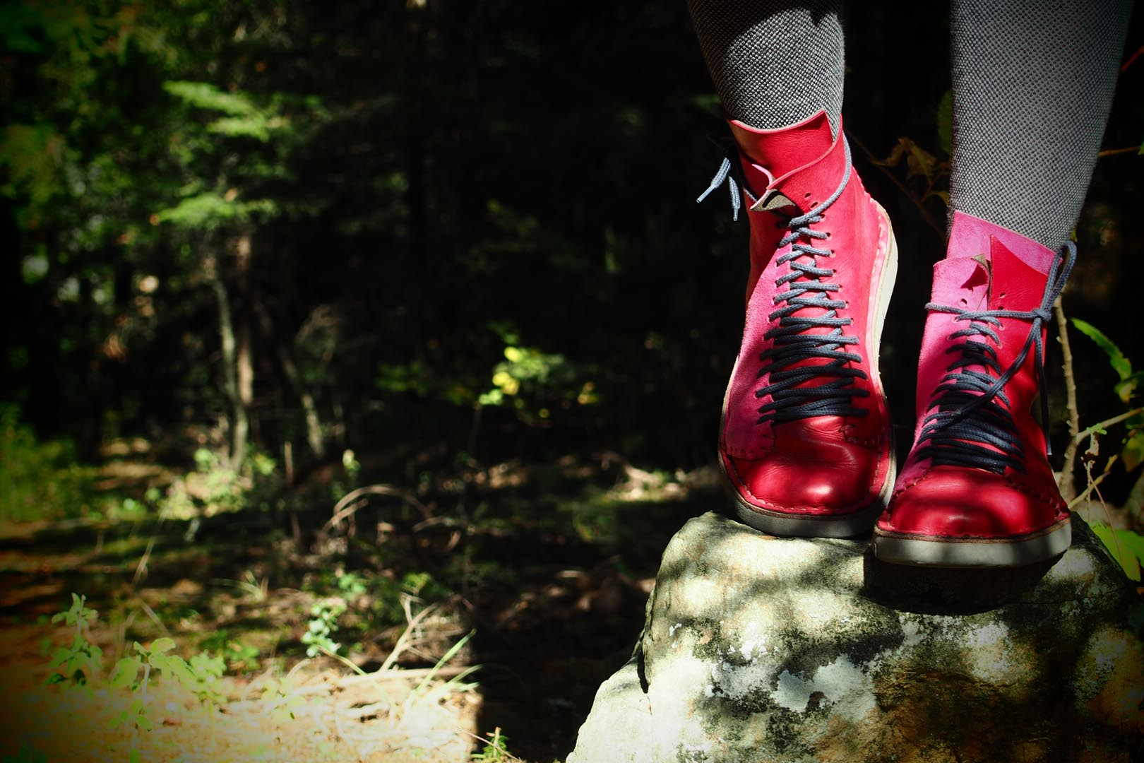 Red leather shoes on a rock